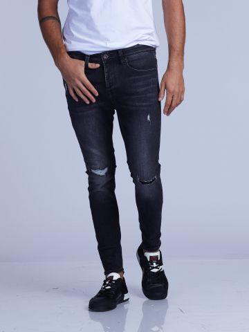 ג'ינס סקיני משופשף במראה USED