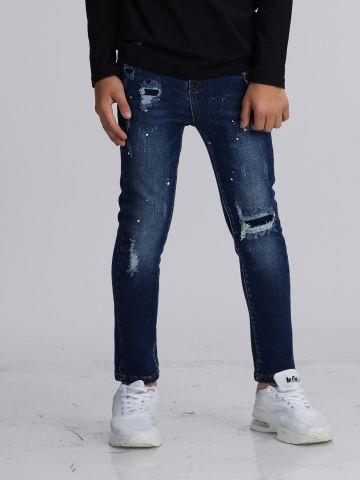 ג'ינס קרעים וכתמים