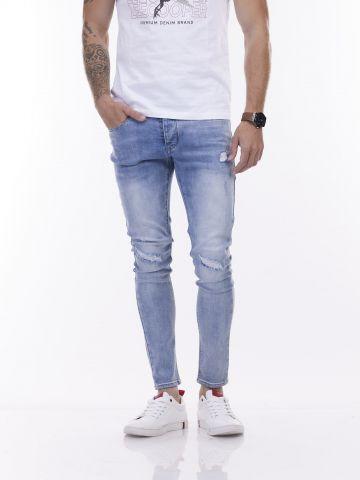 ג'ינס מרטין עם קרעים