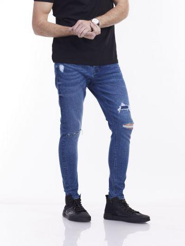 ג'ינס מרטין כחול עם קרעים