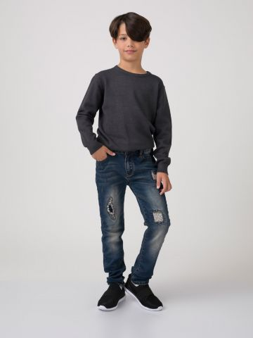 ג'ינס יוזד קרעים