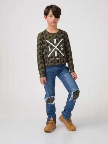 ג'ינס קרעי קמופלאז'