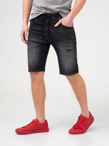 ברמודת ג'ינס עם קרעים