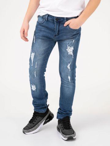 מכנסי ג'ינס קרועים